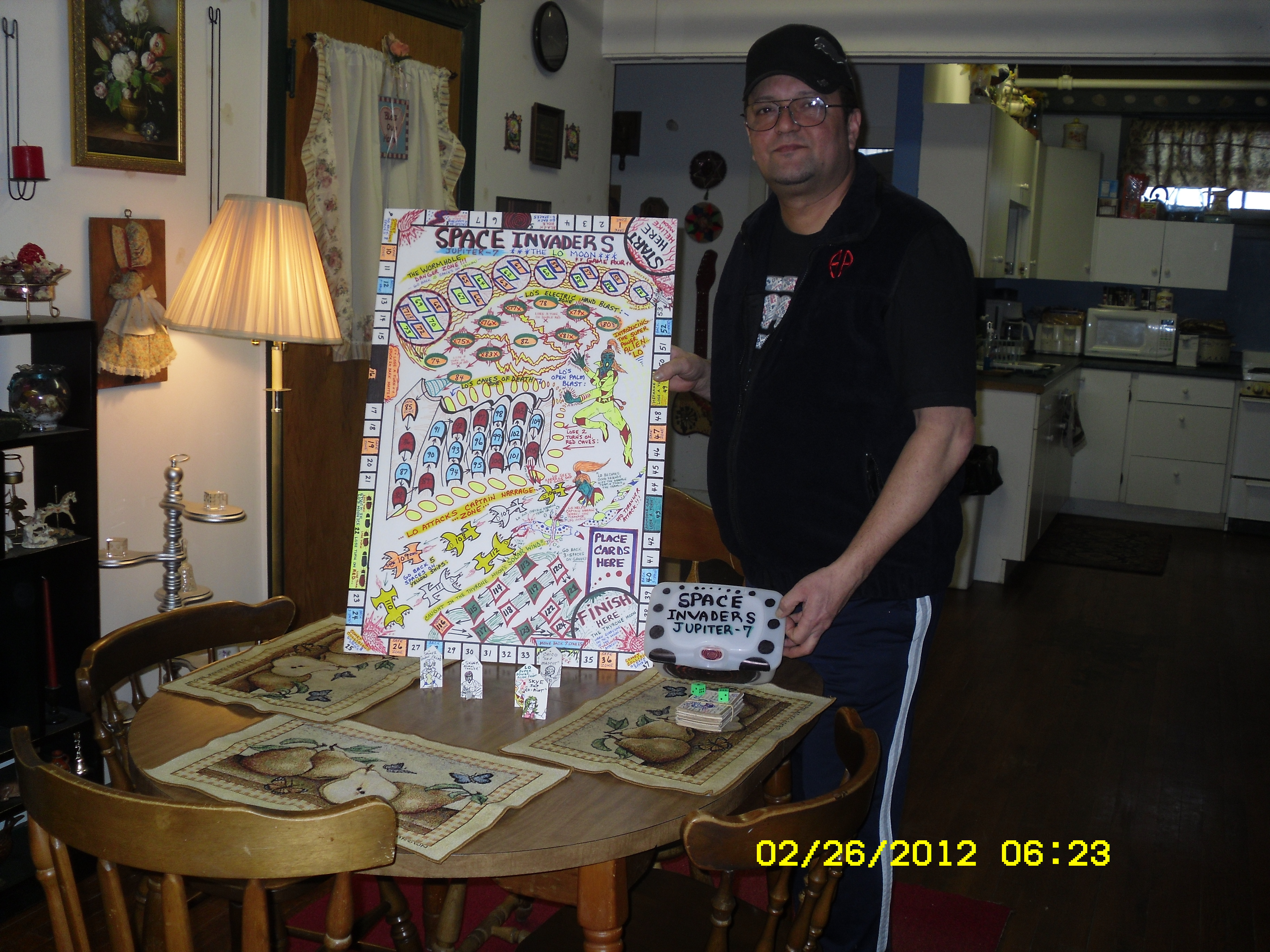 Me standing next to one of my completed board games...
